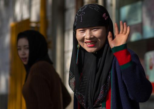 Hui muslim woman smiling in the street, Gansu province, Linxia, China