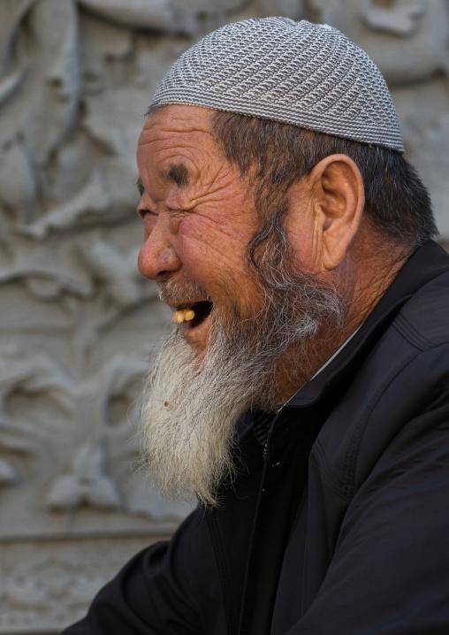 Smiling hui muslim man in the street, Gansu province, Linxia, China