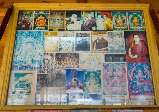 Pictures of Dalai Lama inside Wutun si monastery, Qinghai province, Wutun, China