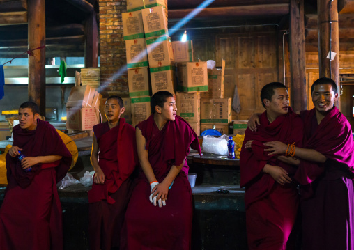 Monks in the kitchen of Rongwo monastery, Tongren County, Longwu, China