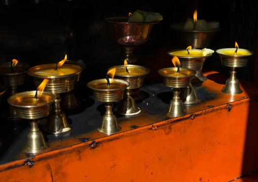 Butter lamps in Rongwo monastery, Tongren County, Longwu, China