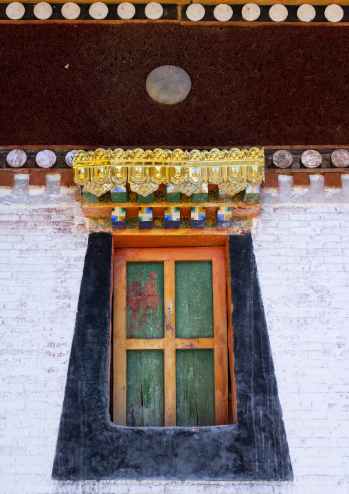 Typical tibetan window on a temple in Rongwo monastery, Tongren County, Longwu, China