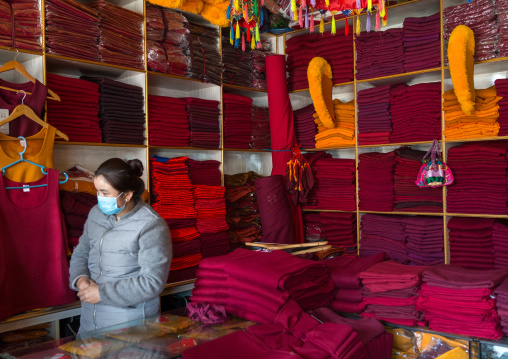 Tibetan shop selling robes and hats for the monks near Rongwo monastery, Tongren County, Longwu, China