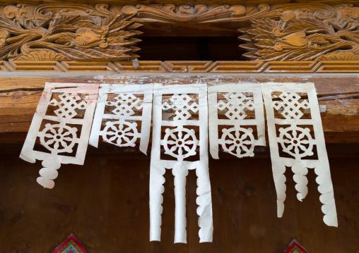 Paper cut hangs on a door to bring luck, Tongren County, Longwu, China