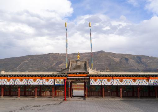 Prayer wheels alley in Rongwo monastery, Tongren County, Longwu, China