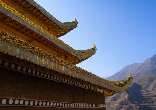 Temple roof in Bongya monastery, Qinghai province, Mosele, China