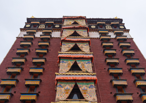 Low angle view of milarepa tower in Hezuo monastery, Gansu province, Hezuo, China