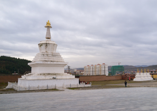 Stupa in front of the modern town in Hezuo monastery, Gansu province, Hezuo, China