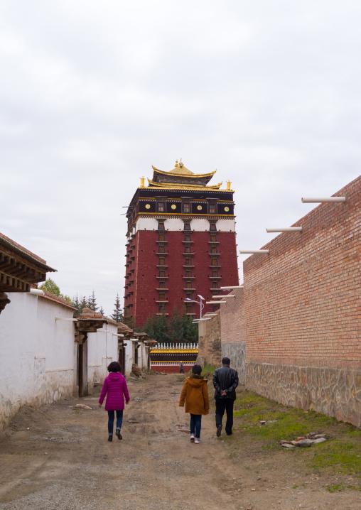 Tibetan pilgrims going to Hezuo monastery and its milarepa tower, Gansu province, Hezuo, China
