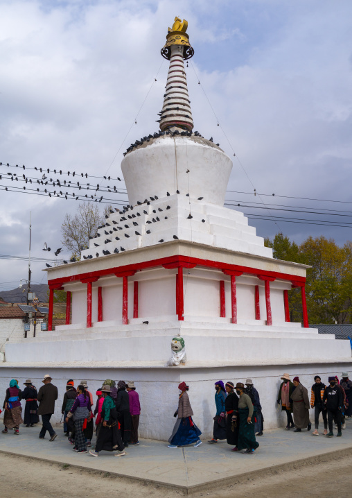 Circumabulation of a stupa by visitors in Labrang monastery, Gansu province, Labrang, China