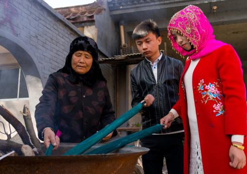 Hui muslim people burning incense stick in Yu Baba Gongbei shrine, Gansu province, Linxia, China