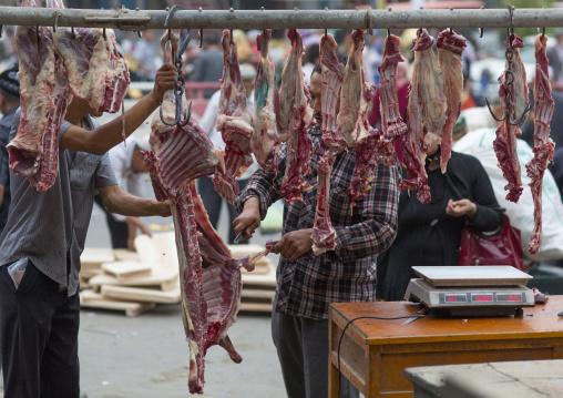 Butcher Cutting Meat For Customers, Hotan, Xinjiang Uyghur Autonomous Region, China