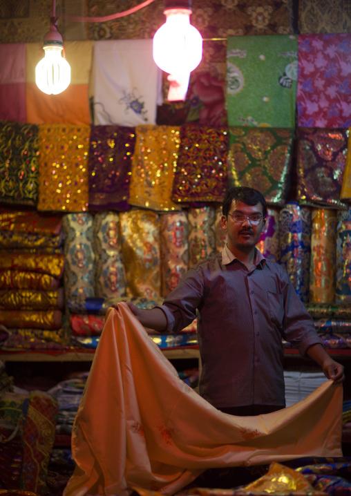 Uyghur Cloth Seller In the bazaar, Hotan, Xinjiang Uyghur Autonomous Region, China