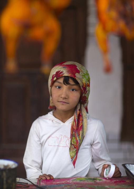 Young Uyghur Girl At Food Stall, Keriya, Old Town, Xinjiang Uyghur Autonomous Region, China