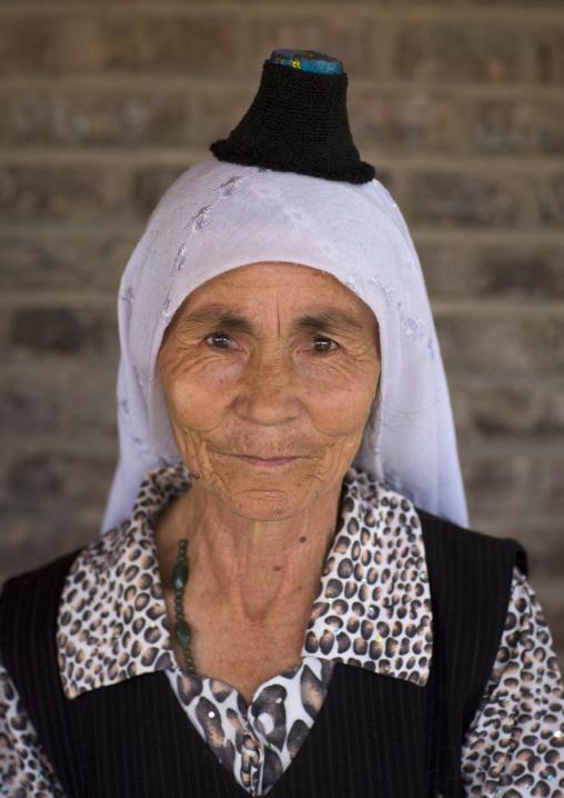 Uyghur Woman Wearing The Smallest Hat In The World, Keriya, Xinjiang Uyghur Autonomous Region, China