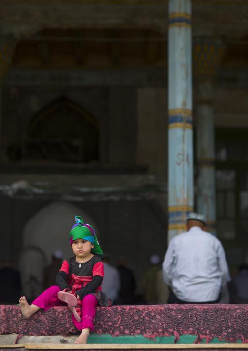 Little Uyghur Girl And Old Uyghur Man in Keriya mosque, Xinjiang Uyghur Autonomous Region, China