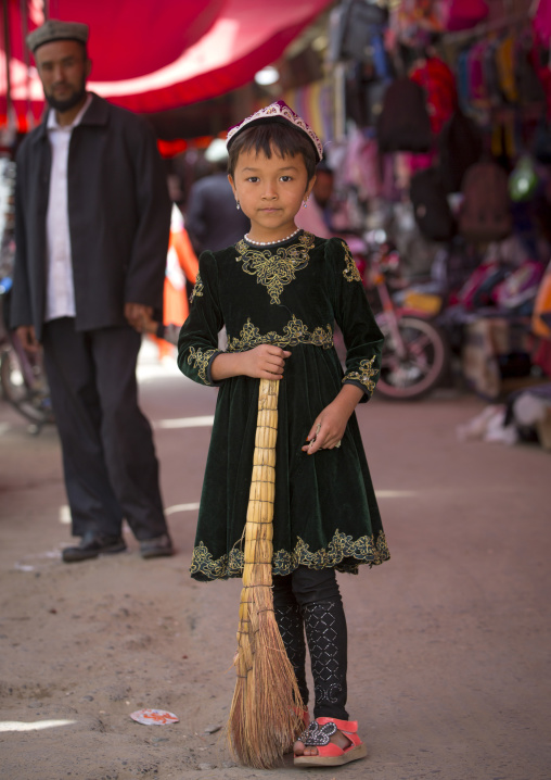 Young Uyghur Girl With A Broom In Minfeng Covered Market, Xinjiang Uyghur Autonomous Region, China
