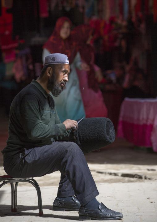 Uyghur Man Making A  sheem skin Hat, Minfeng, Xinjiang Uyghur Autonomous Region, China