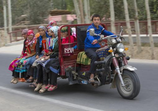 Uyghur Teenager Driving Girls In A Cart, Hotan, Xinjiang Uyghur Autonomous Region, China