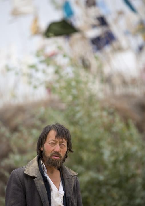 Uyghur Sufi Man At Imam Asim Tomb In The Taklamakan Desert, Xinjiang Uyghur Autonomous Region, China