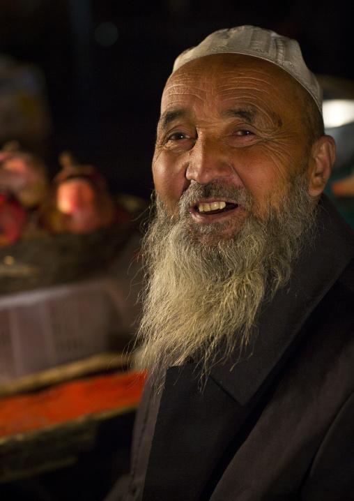 Smiling Uyghur Man In Night Market, Hotan, Xinjiang Uyghur Autonomous Region, China