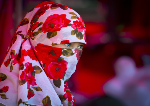 Young Uyghur Woman With Covered Face And Colourful Headscarf, Xinjiang Uyghur Autonomous Region, China