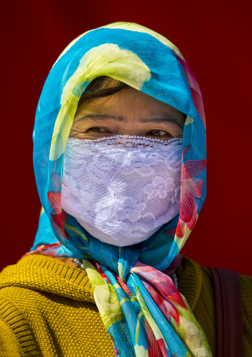 Uyghur Woman With Covered Face And Colourful Headscarf, Xinjiang Uyghur Autonomous Region, China