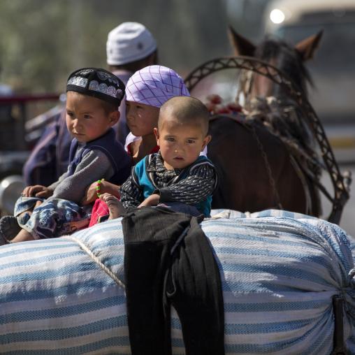 Uyghur Kids On A Horse Pulled Cart, Yecheng, Xinjiang Uyghur Autonomous Region, China