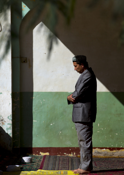 Man Praying Inside Altyn Mosque, Yarkand, Xinjiang Uyghur Autonomous Region, China