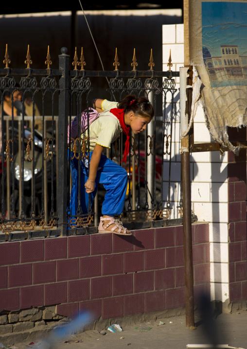 Uyghur Girl Going Out Of School, Yarkand, Xinjiang Uyghur Autonomous Region, China