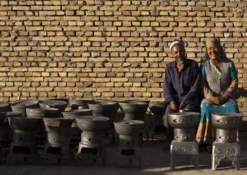 Smiling Uyghur Couple Selling Wood Stoves, Yarkand, Xinjiang Uyghur Autonomous Region, China