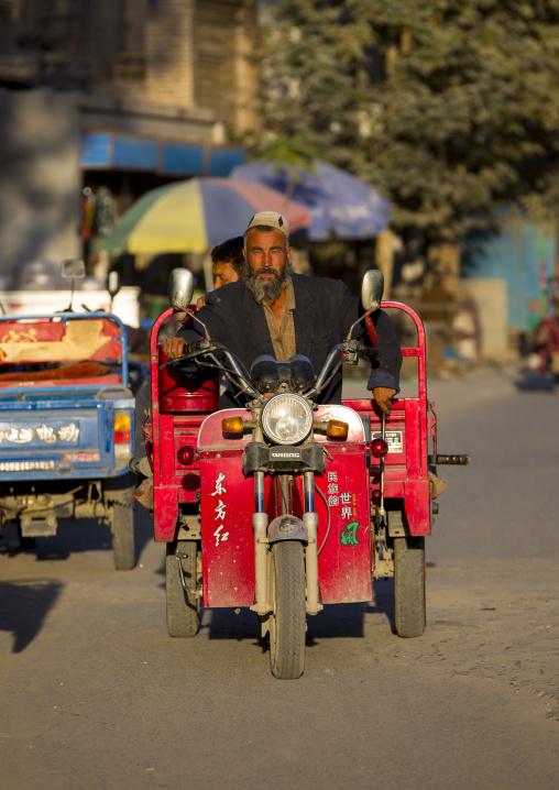 Uyghur Man Driving A Motorized Cart, Yarkand, Xinjiang Uyghur Autonomous Region, China