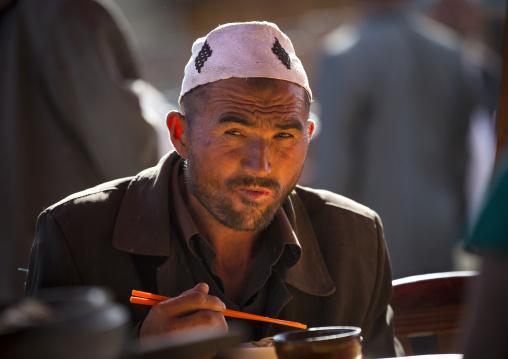 Uyghur Man Eating In Serik Buya Market, Yarkand, Xinjiang Uyghur Autonomous Region, China