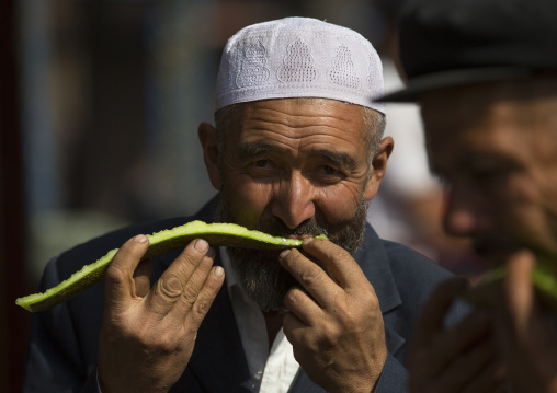 Uyghur Men Eating Watermelon, Serik Buya Market, Yarkand, Xinjiang Uyghur Autonomous Region, China