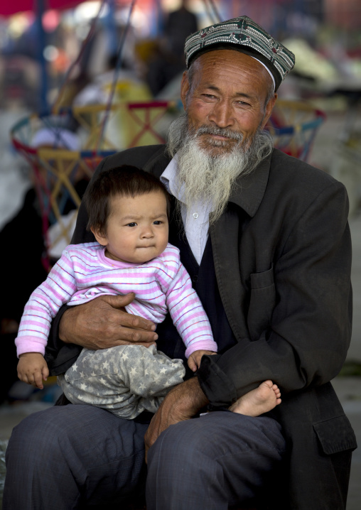 Old Uyghur Man And Baby, Serik Buya Market, Yarkand, Xinjiang Uyghur Autonomous Region, China