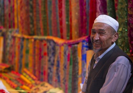 Uyghur Man Selling Cloth In Serik Buya Market, Yarkand, Xinjiang Uyghur Autonomous Region, China
