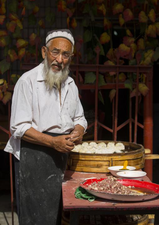 Old Uyghur Man Making Dumplings, Serik Buya Market, Yarkand, Xinjiang Uyghur Autonomous Region, China