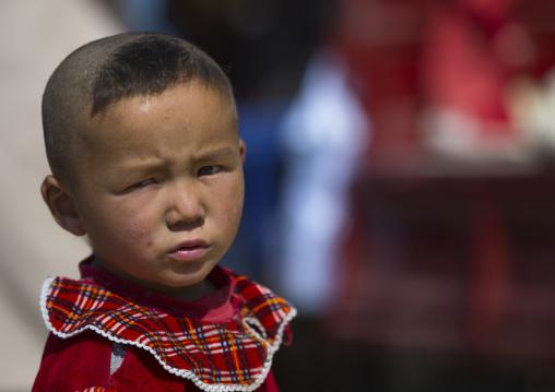 Uyghur boy with new haircut, Serik Buya Market, Yarkand, Xinjiang Uyghur Autonomous Region, China