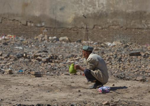 Old Uyghur Man making ablutions, Old Town Of Kashgar, Xinjiang Uyghur Autonomous Region, China