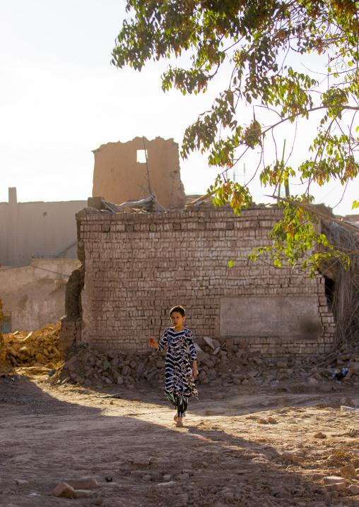 Girl in the Demolished Old Town Of Kashgar, Xinjiang Uyghur Autonomous Region, China