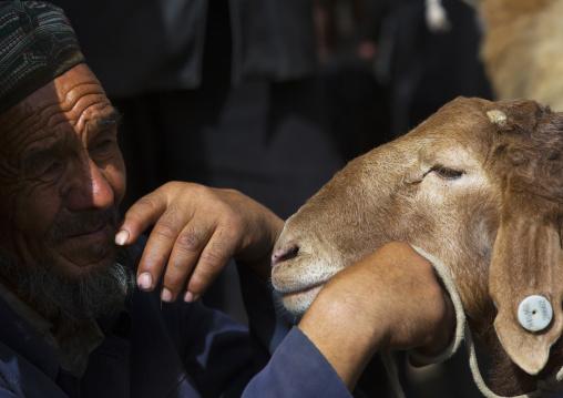 Uyghur Man and his sheep, Opal Village Market, Xinjiang, China, Xinjiang Uyghur Autonomous Region, China