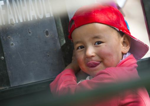 Uyghur Kid smiling, Opal Village Market, Xinjiang Uyghur Autonomous Region, China