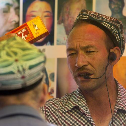 Uyghur Man Sellin Cough Syrup, Opal Village Market, Xinjiang Uyghur Autonomous Region, China