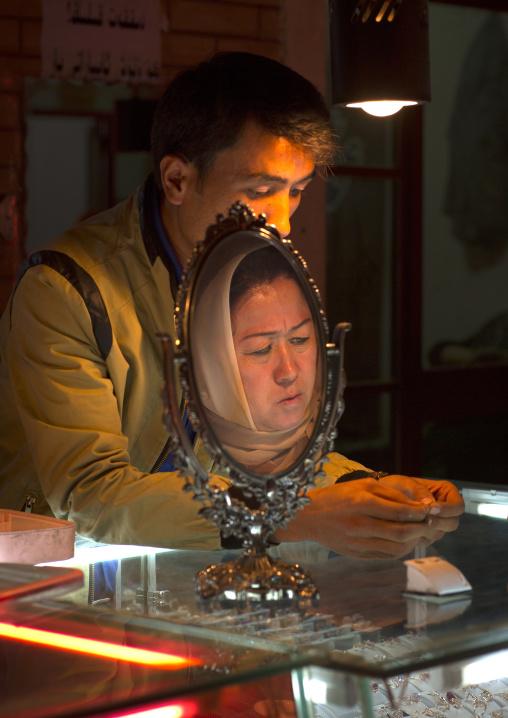 woman head Reflecting In The Mirror, Gold Bazaar, Kashgar, Xinjiang Uyghur Autonomous Region, China