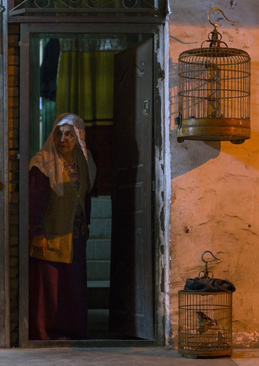 Old Uyghur Woman and bird cages, Kashgar, Xinjiang Uyghur Autonomous Region, China