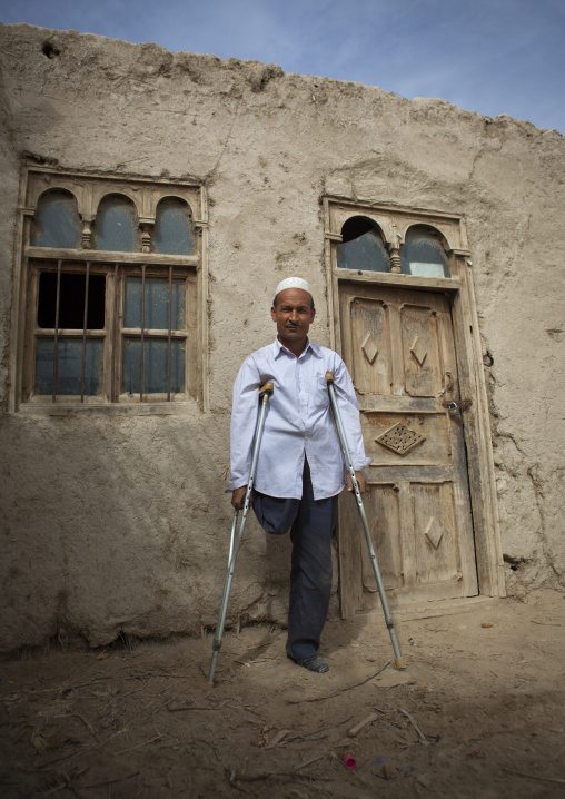 Uyghur Cotton Producer In Front Of A House, Hotan, Xinjiang Uyghur Autonomous Region, China