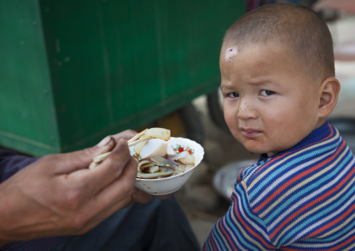Giving Food To A Uyghur Toddler, Keriya, Xinjiang Uyghur Autonomous Region, China