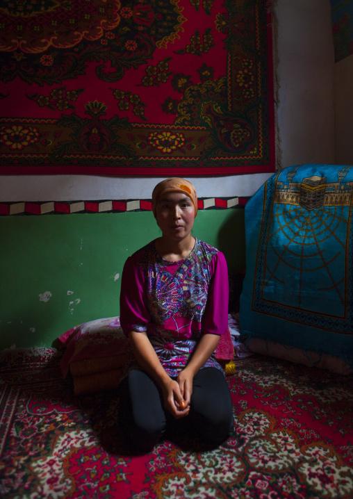 Uyghur Woman In Her Home, Keriya, Xinjiang Uyghur Autonomous Region, China