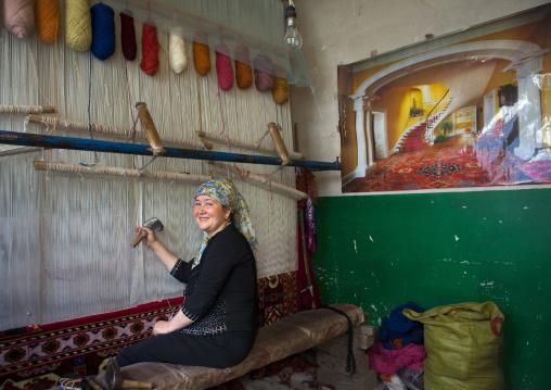 Uyghur Woman Making A Carpet, Keriya, Old Town, Xinjiang Uyghur Autonomous Region, China
