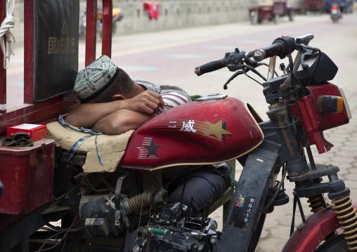 Man Sleeping On His Motorcycle, Xinjiang Uyghur Autonomous Region, China